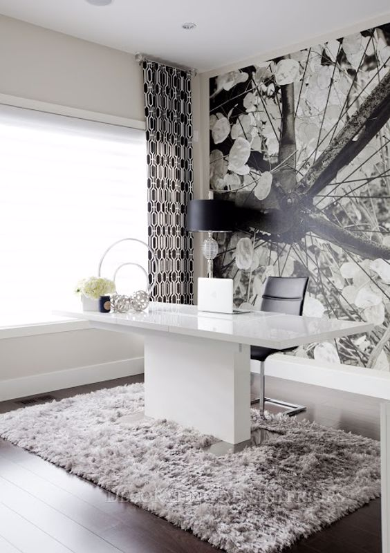A black and white color scheme can look very modern in a home office.