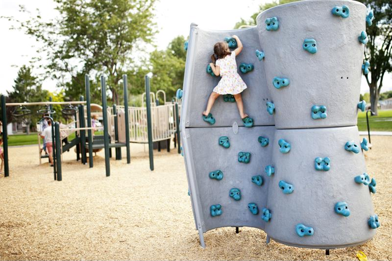 Let your preschooler explore that climbing wall -- she's building valuable life skills in the process!