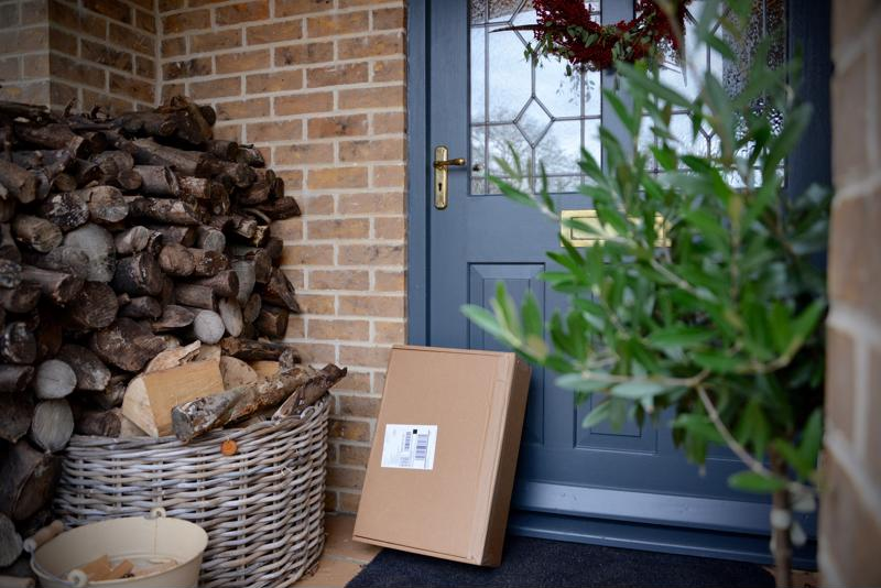 A package resting on the front door of a home.