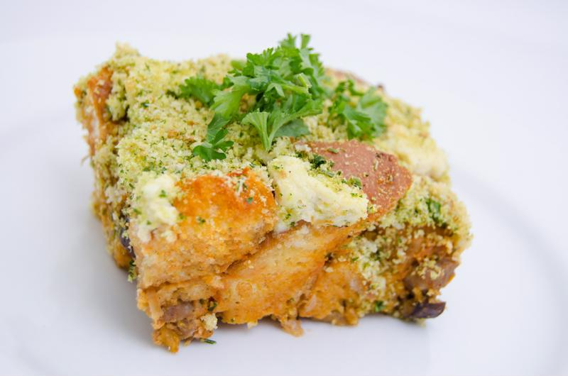 Top your bread pudding with Parmesan cheese and parsley for garnish.