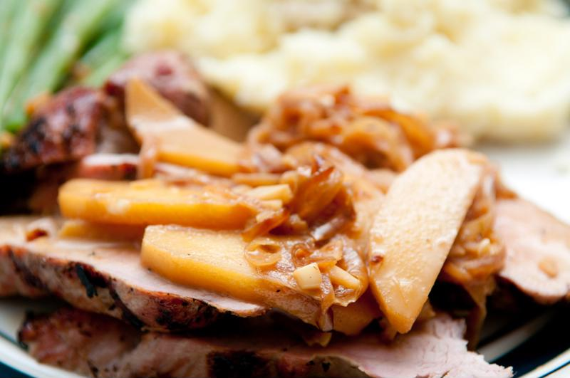 Pork roast with apple slices.