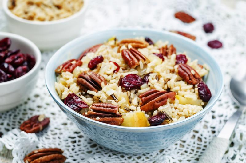 Adding fruit and nuts to leftover wild rice can make for a filling and delicious breakfast.