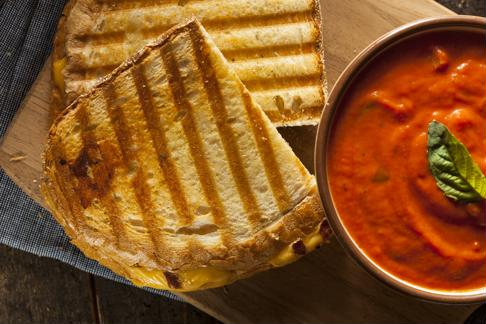 Serve fresh tomato soup with a grilled cheese sandwich for a classic dish.