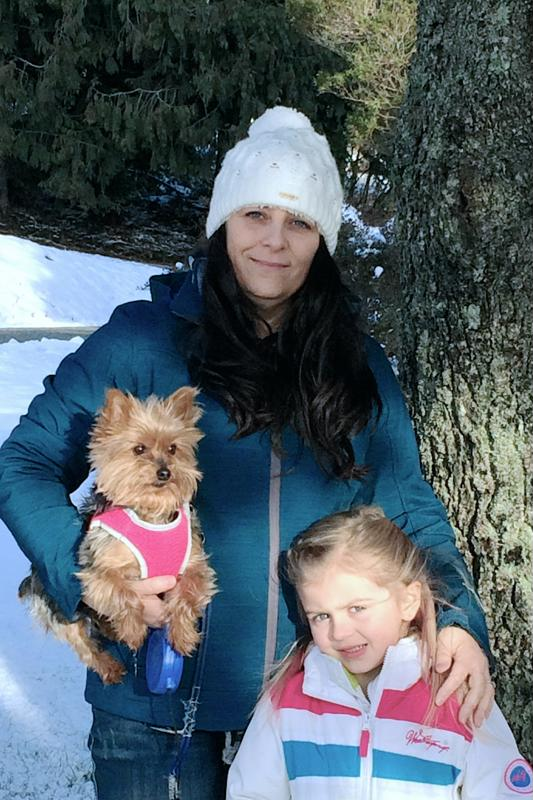 Cheri with granddaughter and dog, Bebe.