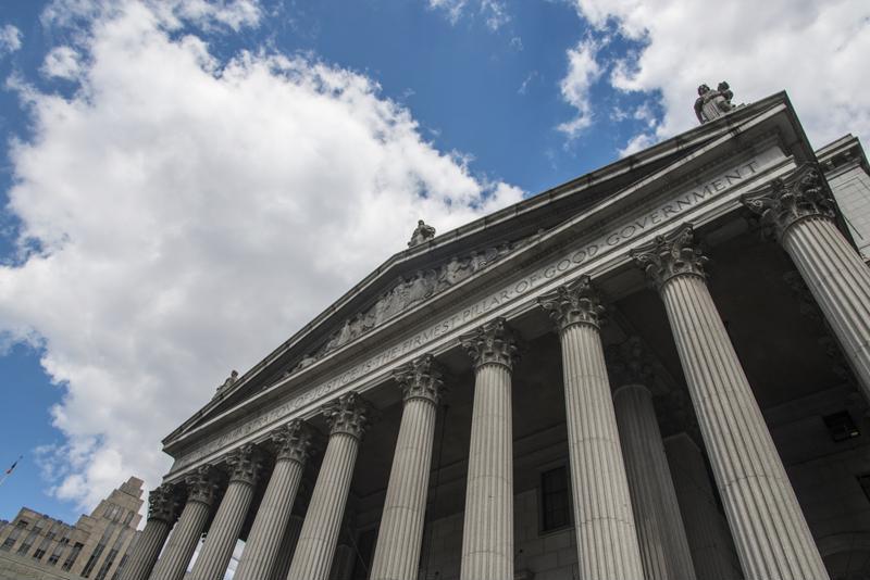 Facade of Supreme Court building entrance.