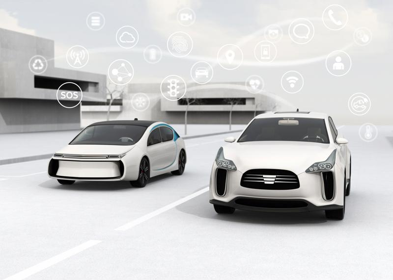 Conceptual image of two futuristic cars surrounding by icons representing digital services.