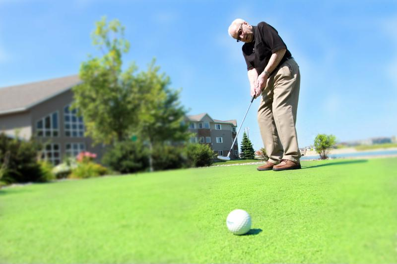 Edgewood Management senior golfing.