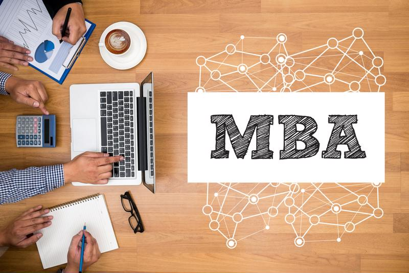 MBA graphic and laptop.