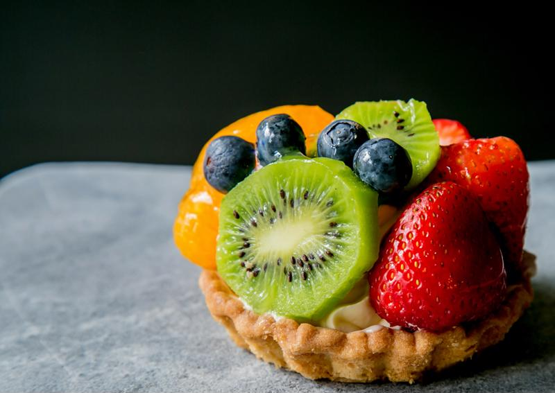 Fruit tart on black and white background.