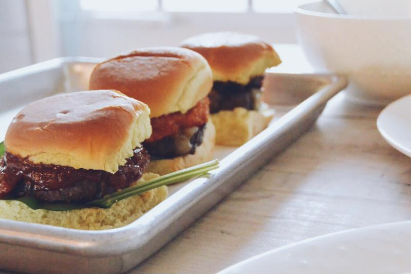 Burger sliders on a tray.