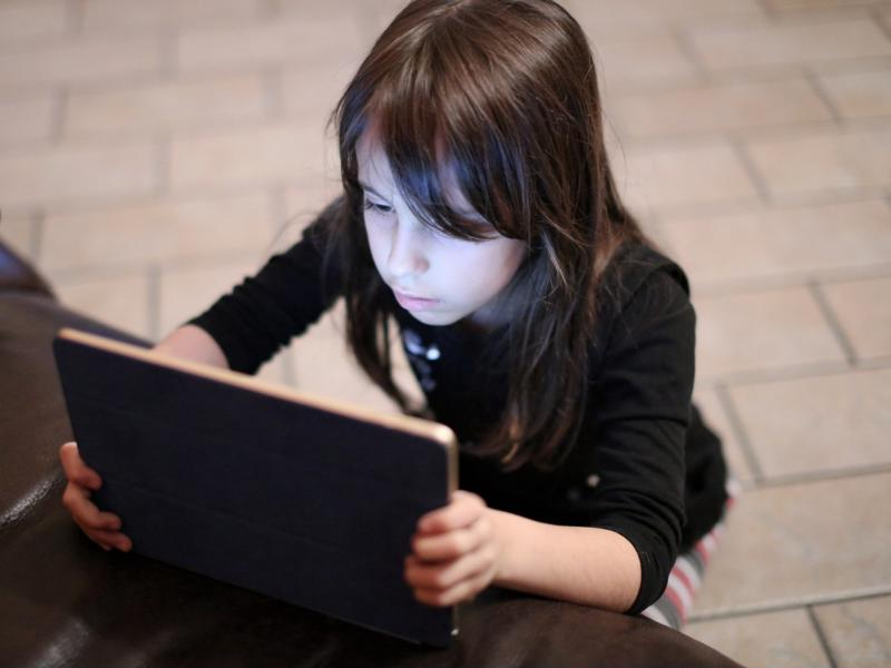 Girl using a tablet.