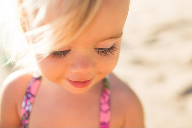 Beach photography should take place during sunrise or sunset to avoid squinty eyes and dark shadows underneath the eyes.