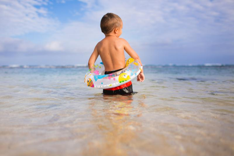 When it comes to photographing your child at the beach, make water the foreground to get an interesting shot.