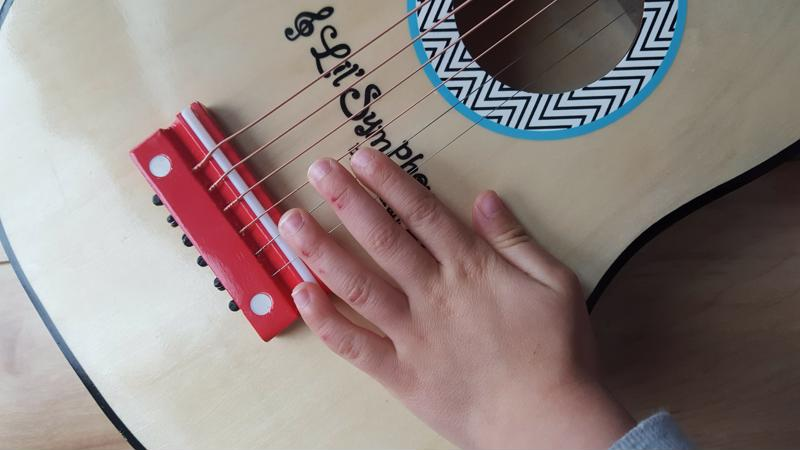 This photo was taken the morning after my two-year-old received his first guitar. Note the cuts on his fingers!