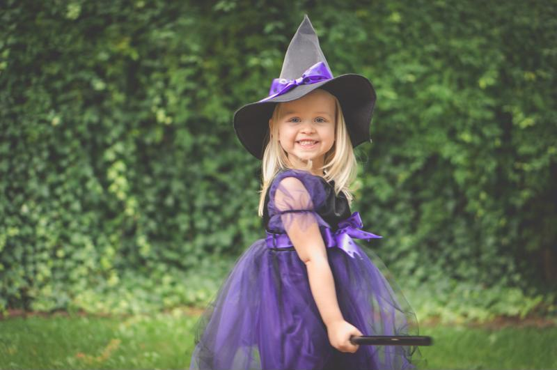 girl dressed up in a witch costume