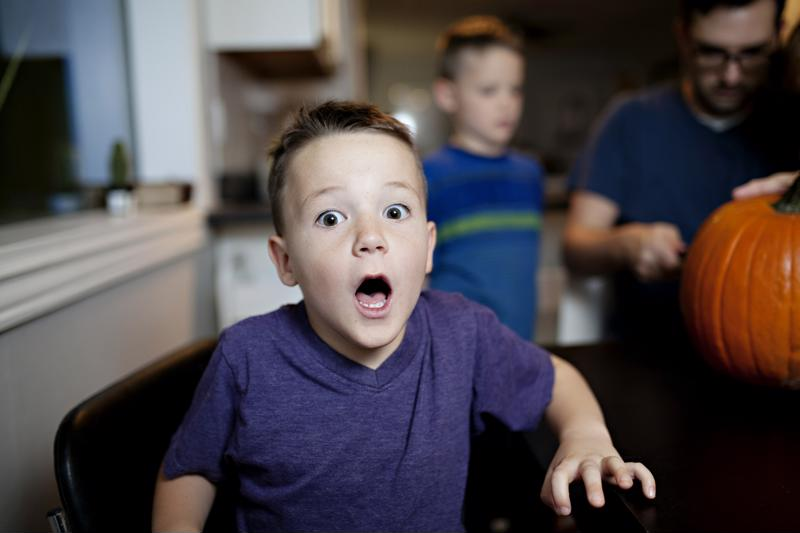 Little boy with open mouth, surprised.