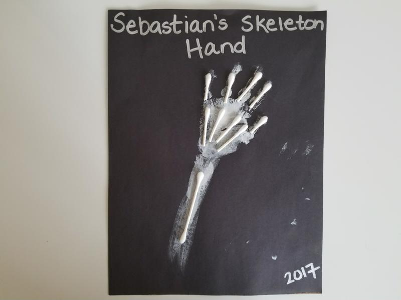The spookiest craft of the bunch, the skeleton arm features your toddler's handprint plus cotton swab bones.