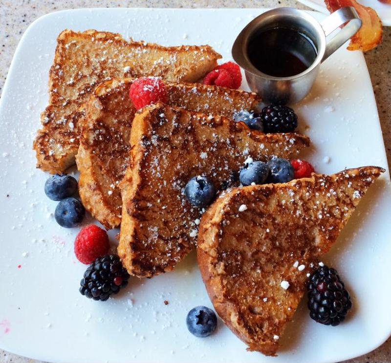 Top your French toast with berries and syrup.