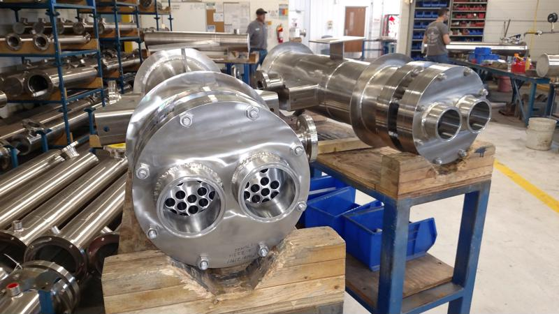 A stainless steel shell and tube heat exchanger is made at Enerquip.