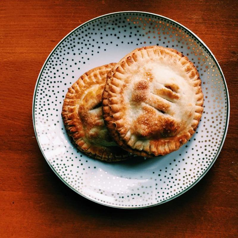 Fried hand pies on a plate.