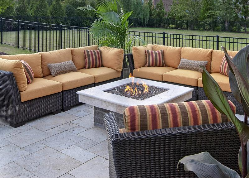 Outdoor fire pit, patio furnture, natural greenery
