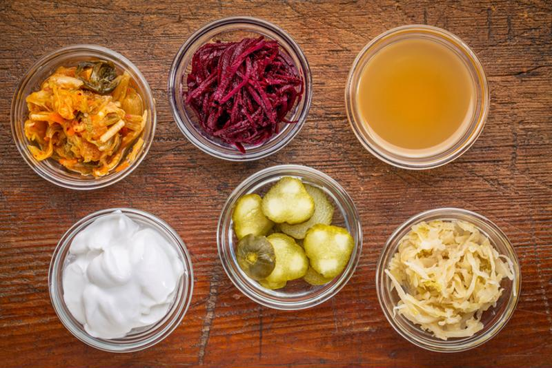 Fermented food in small bowls on a table.