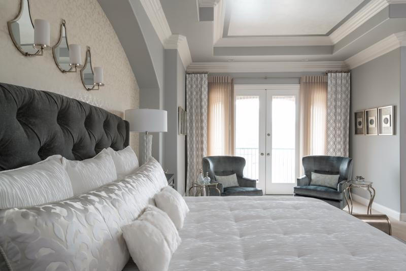 Bedroom with gray,white and silver color scheme.