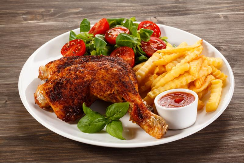 Chicken, fries and vegetables on a plate
