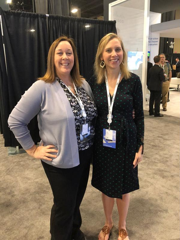 Two female Galileo employees at a recent conference.
