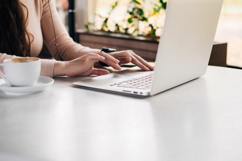 Hands using laptop