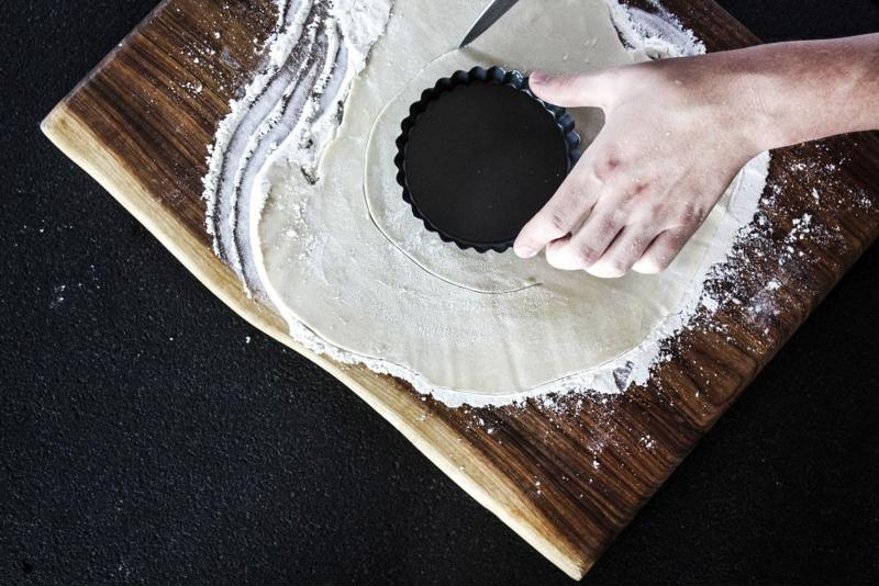 Cutting out dough.