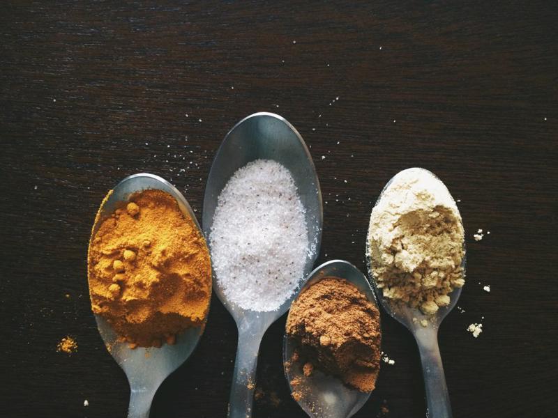 Spoons holding sweeteners.