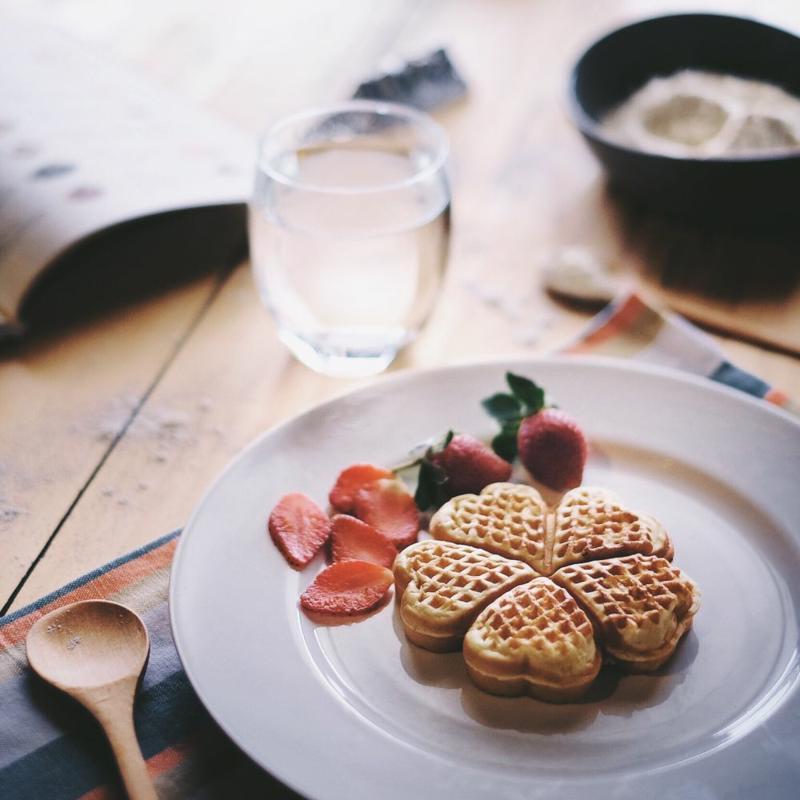 Heart-shaped waffles on a plate.
