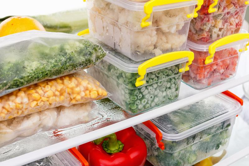 Stacked containers in a fridge