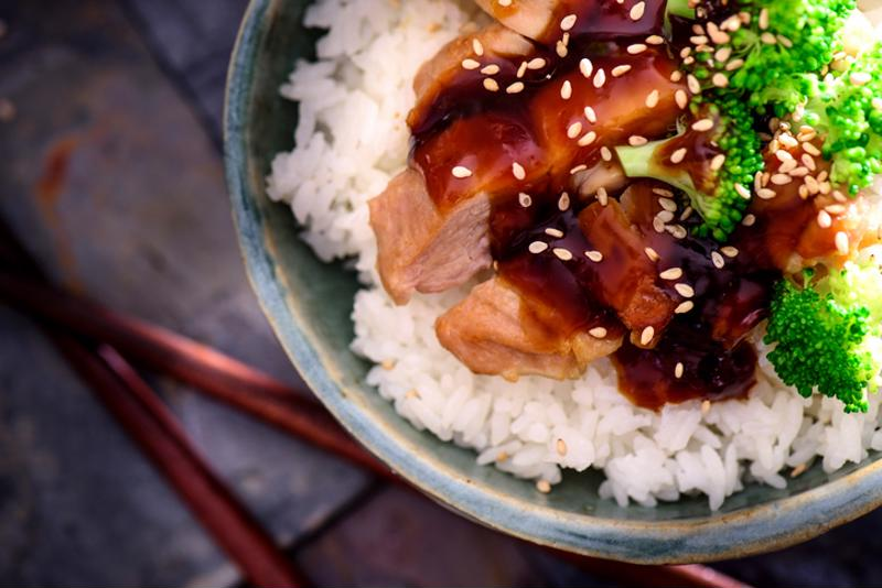 Teriyaki marinade over meat and rice