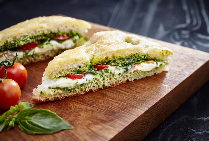 A sandwich with pesto marinade