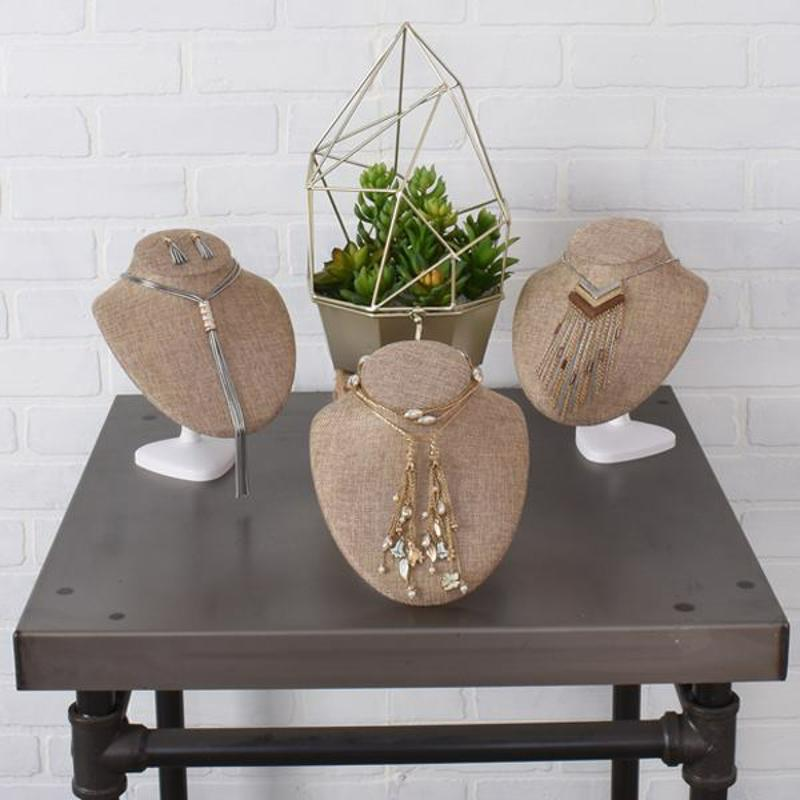 Burlap is a trendy, practical choice for jewelry displays.