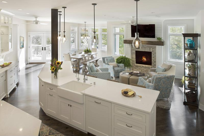Kitchen and living design by Decorating Den Interiors