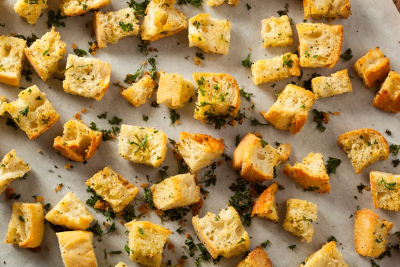 Croutons with herbs on a baking tray