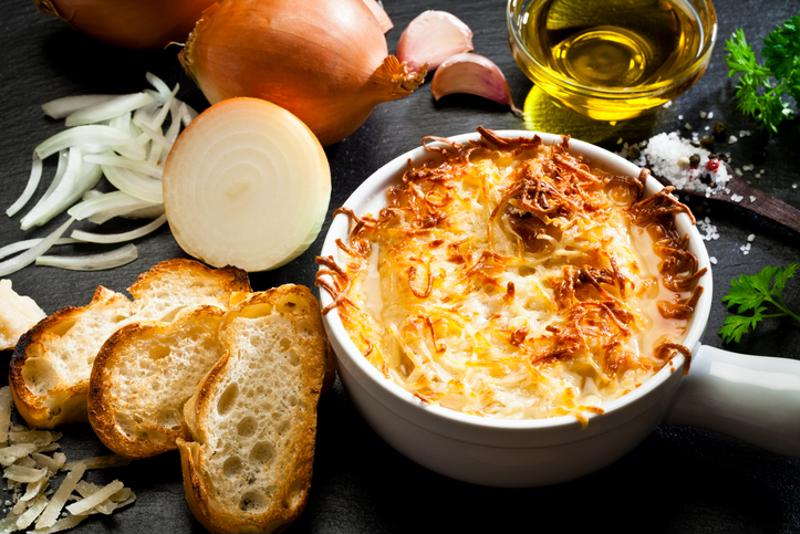 French onion soup and ingredients on a table