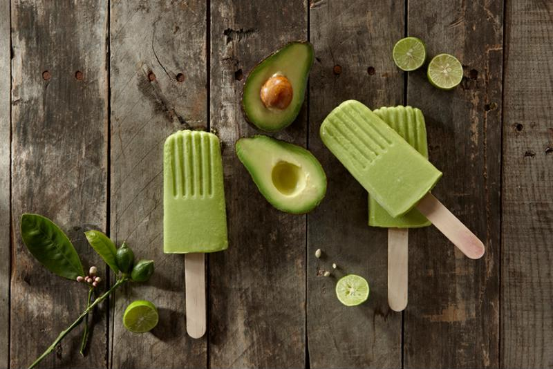 Avocado lollies and avocados on a table