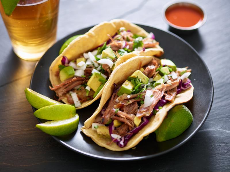 Two pork carnitas on a plate