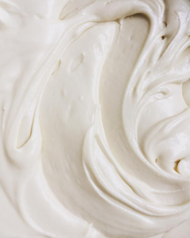 A close-up view of white frosting.