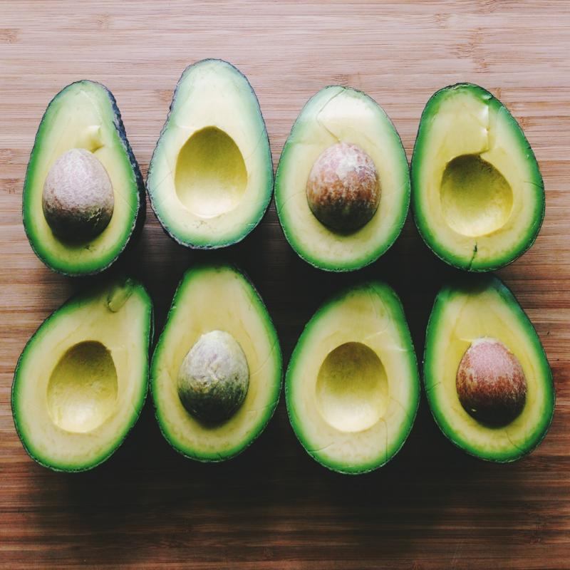 Halved avocados can be used as a vessel for baked eggs.