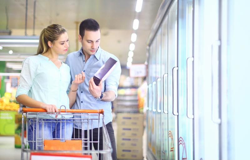 Couple looking at food in the grocery store