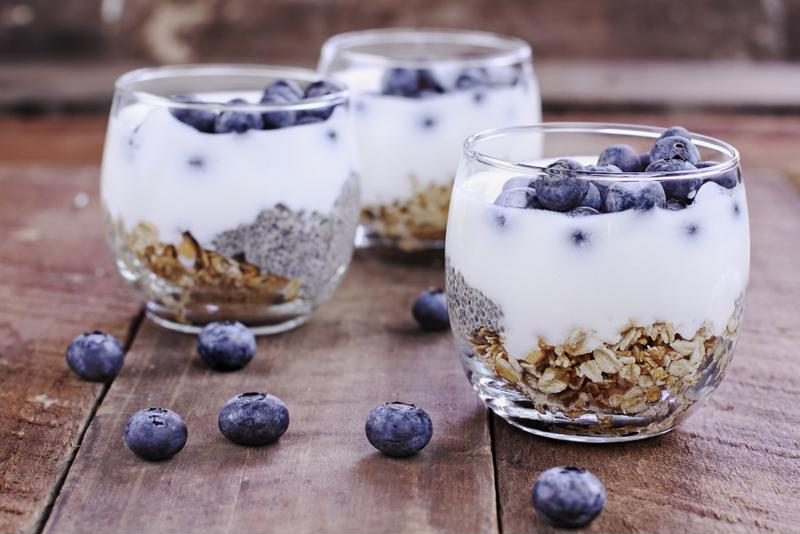 A group of yogurt, oat and berry parfaits.