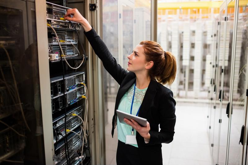 Woman checking a server room
