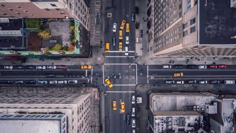 A bird's eye view of a traffic intersection.