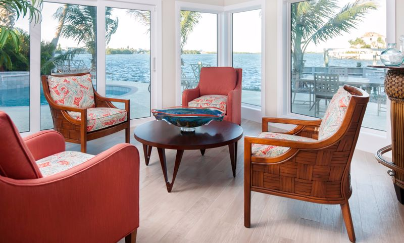 Warm red accents in your sunroom furniture are perfect for fall and winter.