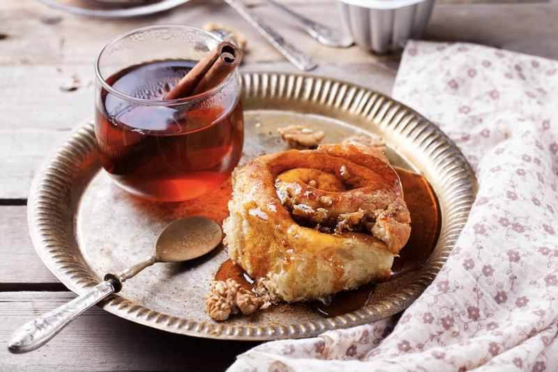 A breakfast pastry topped with maple syrup.